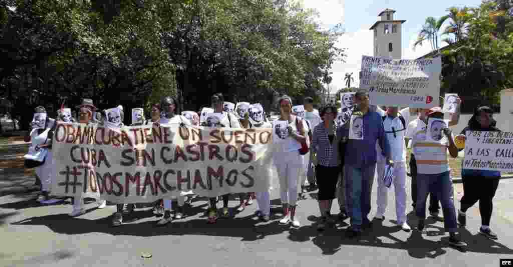 Opositores al gobierno cubano marchan hoy, domingo 13 de marzo del 2016, a pocos días de la visita del presidente Barack Obama a La Habana