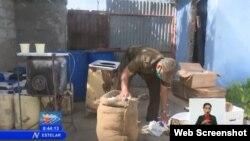Productos incautados en fábrica ilegal de mantequilla, en Camagüey, según reporte de la televisión estatal.