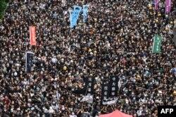 Estudiantes de la Universidad China de Hong Kong en una marcha el 2 de septiembre (Foto: Philip Fong/AFP).