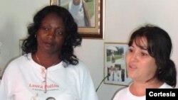 La actual líder de las Damas de Blanco, Berta Soler junto a Laura Labrada