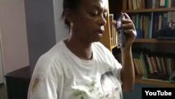 Reporta Cuba. Dama de Blanco Jacqueline Boni fue severamente maltratada ayer en La Habana. Foto: tomada de Youtube.