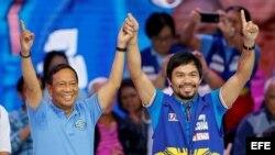 (i-d) El actual vicepresidente de Filipinas, líder del partido opositor Alianza Nacionalista Unida y candidato presidencial, Jejomar Binay, y el campeón de boxeo Manny Pacquiao.
