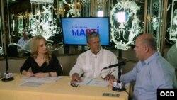 De izquierda a derecha los presentadores Karen Caballero Alfredo jacomino y el Subdirector adjunto Emilio Vazquez durante la programacion en vivo desde el restaurant Versailles en la Pequeña Habana, celebrando la independencia de la nación cubana, fotografía Roberto Koltun OCB Staff