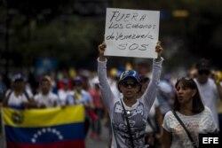 Un grupo de personas participó en una manifestación en contra del Gobierno del presidente Nicolás Maduro el domingo 16 de marzo de 2014, en el sector Chacao en Caracas, Venezuela.