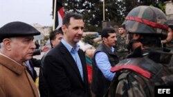 En el centro el mandatario sirio Bashar Al Assad