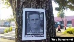 Un afiche con la imagen de José Daniel Ferrer en una calle de Santiago de Cuba pide su libertad y la de todos los presos políticos. (UNPACU)