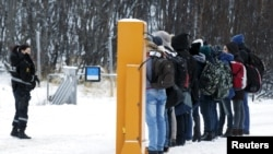 Migrantes en la frontera entre Rusia y Noruega. REUTERS/Cornelius Poppe/NTB Scanpix