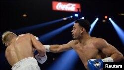 Rolando Romero (der.) conecta un golpe contra Arturs Ahmetovs, durante su pelea en la MGM Grand Garden Arena, el 22 de febrero del 2019. (Joe Camporeale/USA TODAY Sports).