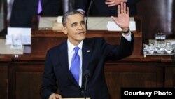 El presidente de EEUU Barack Obama, saluda a los asistentes antes de pronunciar el discurso del Estado de la Unión.