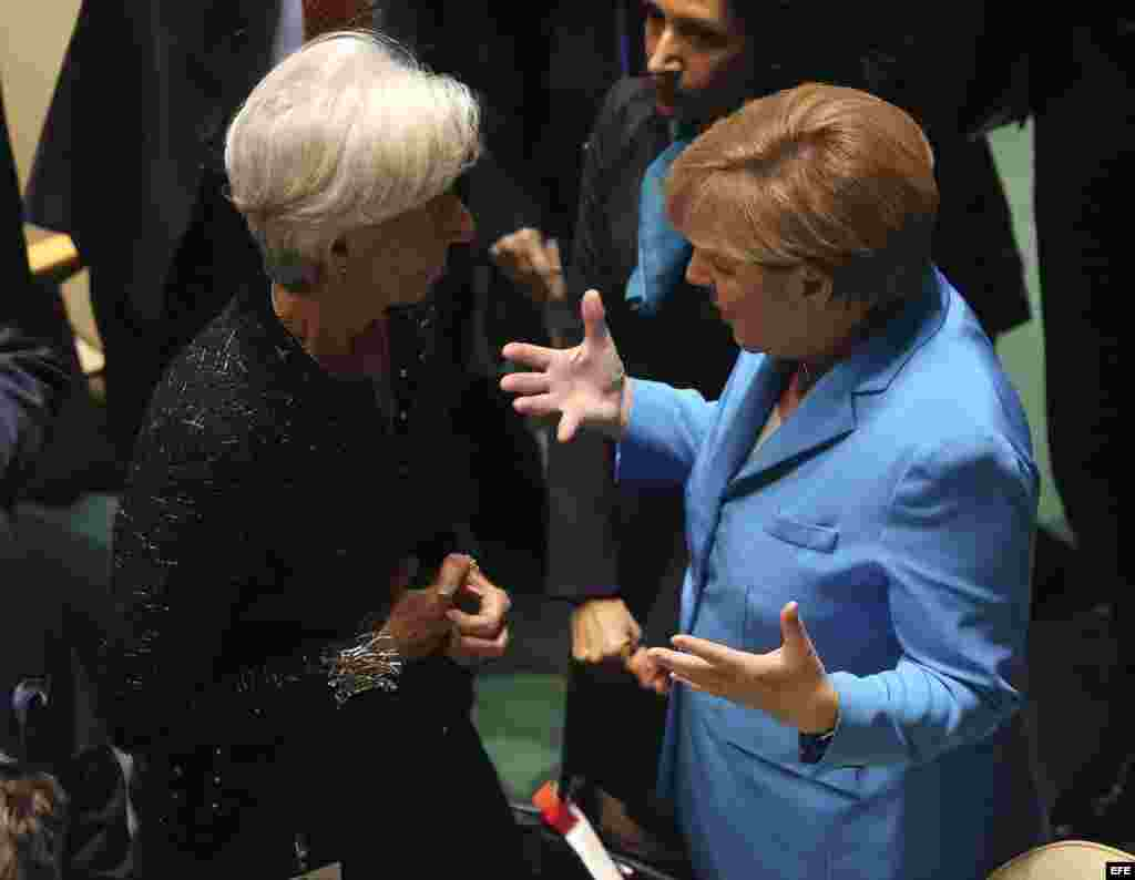 La canciller alemana, Angela Merke (d) y la directora del Fondo Monetario Internacional (FMI), Christine Lagarde, antes del inicio de la cumbre de la ONU