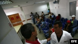 "Part of the ""Barrio Adentro"", or Inside the Neighborhood program, two Cuban doctors talk in the Integral Diagnostic Center."
