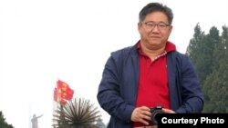 Kenneth Bae durante un viaje a China