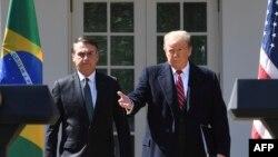 El presidente Donald Trump y su homólogo brasileño, Jair bolsonaro, se dirigen a la prensa en la Casa Blanca.