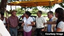 Representantes de la ONG Oikos en Cuba