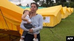 Migrantes venezolanos en un campo para refugiados en Bogotá, Colombia. (Raul Arboleda / AFP).