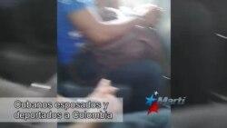 Cubanos varados en Panamá son esposados y deportados a Colombia