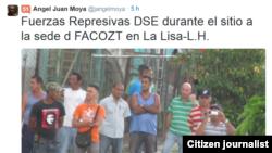 Reporta Cuba. Segurosos vigilan la casa donde se realizaría almuerzo para necesitados.
