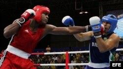 Robert Alfonso (i), se enfrenta al brasileño Antonio Nogueira, por las semifinales de la categoría +91 kg, en los Juegos Panamericanos Río 2007.