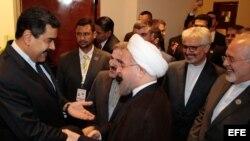 El presidente de Irán, Hasán Rouhaní (d), durante su encuentro el viernes con su homólogo venezolano, Nicolás Maduro (i),en Margarita (Venezuela). El mandatario persa entregará a Maduro la Presidencia Pro Tempore (PPT) del bloque de los No Alineados.