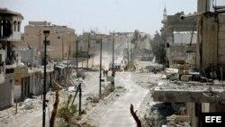 Vista de la ciudad siria de Al Quseir, en la frontera con Líbano, destruida por los ataques de las tropas gubernamentales.