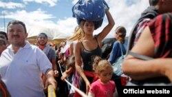 Migrantes venezolanos huyen de la crisis en el país petrolero.