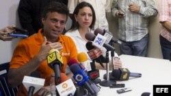María Corina Machado, dirigente opositora venezolana junto a Leopoldo López.