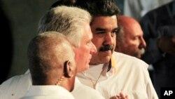 Miguel Díaz-Canel y Nicolás Maduro. Foto Jorge Luis Banos/Pool Photo via AP.