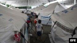 Niños juegan en el refugio de inmigrantes venezolanos Nova Canaa 8, en Boa Vista, Roraima (Brasil).