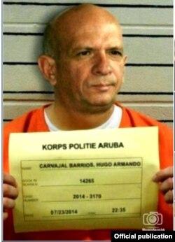 Mugshot: El general chavista Hugo Carvajal posa para la policía de Aruba