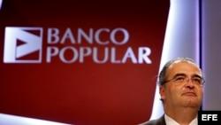 El presidente del Banco Popular, Ángel Carlos Ron, en una junta de accionistas de 2014.