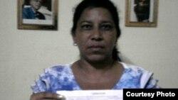 Liberan a Dama de Blanco arrestada antes de la misa a la virgen el 24