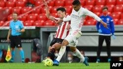 La contienda se define entre el Atlético de Madrid y el Real Madrid. (Ander GILLENEA / AFP)