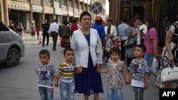 Mujer de la minoría étnica uigur en China. (Greg Baker / AFP).