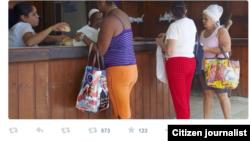 Reporta Cuba. Banderas y foto de Obama. Foto: Yusnaby.