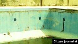 Reporta Cuba. Estanque de agua podrida. Foto: Misael Aguilar.
