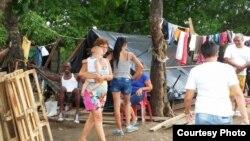 Cubanos varados en Turbo, Colombia, expanden su albergue