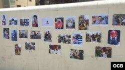 """Las """"fotos de abusos, atropellos y arbitrariedades del régimen contra su pueblo"""" cubren el muro de la embajada de Cuba en Madrid."""