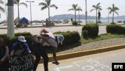 Protesta por las calles del puerto de Acapulco (México) para exigir la presentación con vida de los 43 estudiantes.