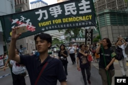 Pro-democracy activists march for the vindication of the June 4 massacre in Hong Kong