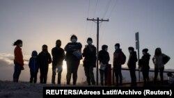 Migrantes en la frontera de México y Estados Unidos. (Adrees Latif / Reuters).