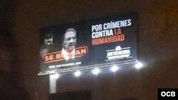 Valla publicitaria que condena a los dictadores de Cuba y Venezuela Raúl Castro y Nicolás Maduro.