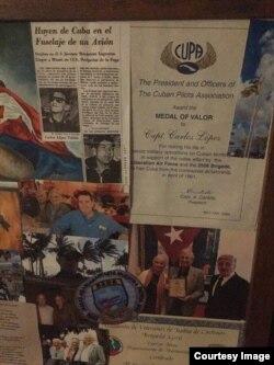 reconocimientos a Carlos López por su trabajo en Estados Unidos.