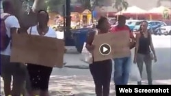 Protesta frente al Parque de la Fraternidad para exigir la liberación de los activistas de UNPACU. (Captura de video/Facebook)